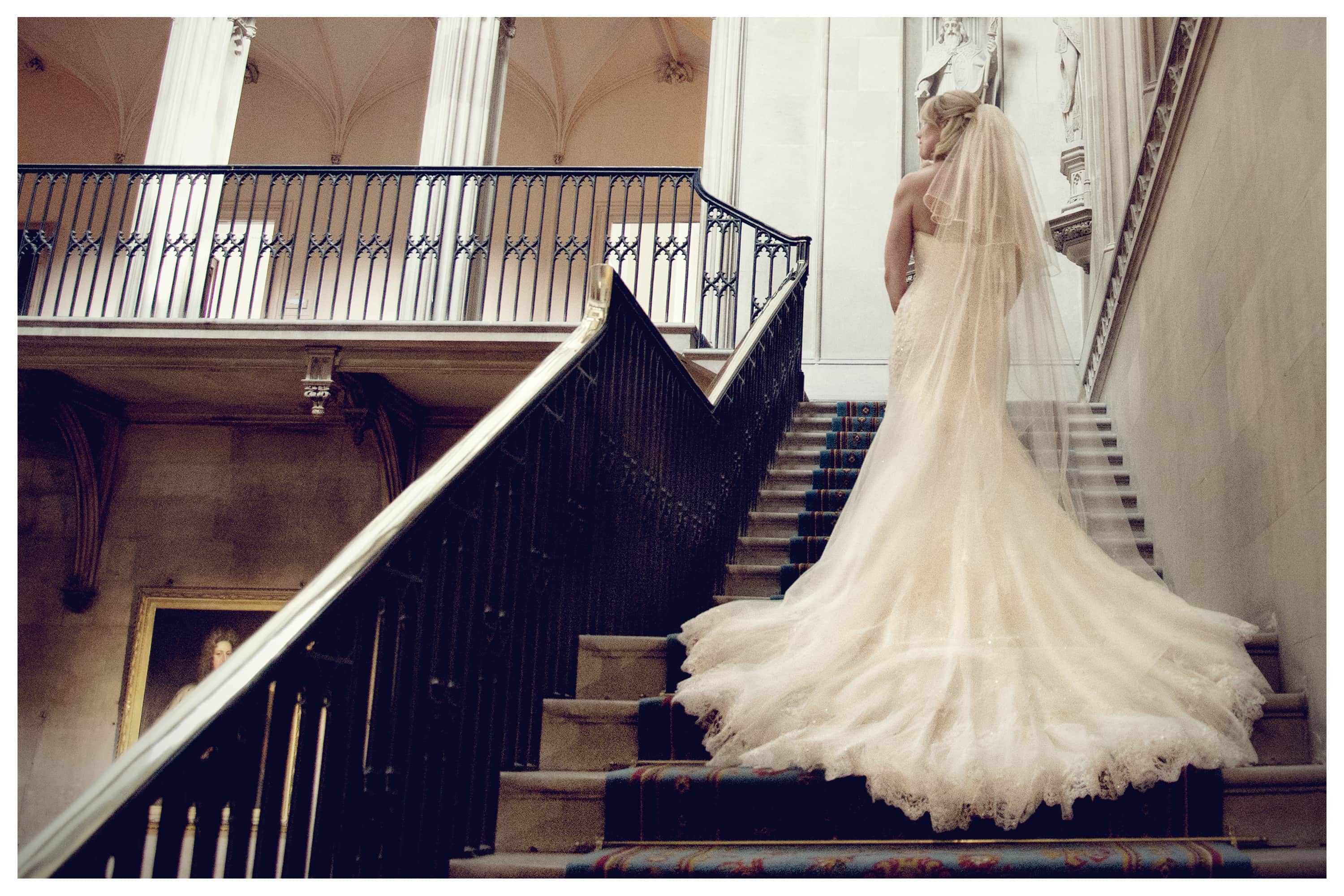 Bride on staircase at Ashridge House, Berkhamsted Hertfordshire - Wedding Photography