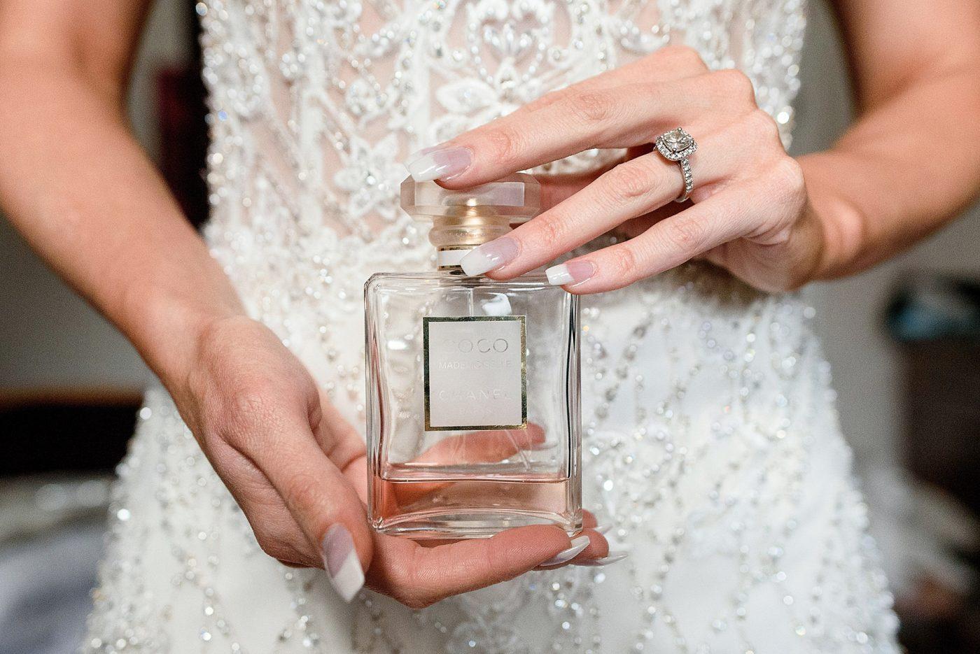 bride holding chanel perfume
