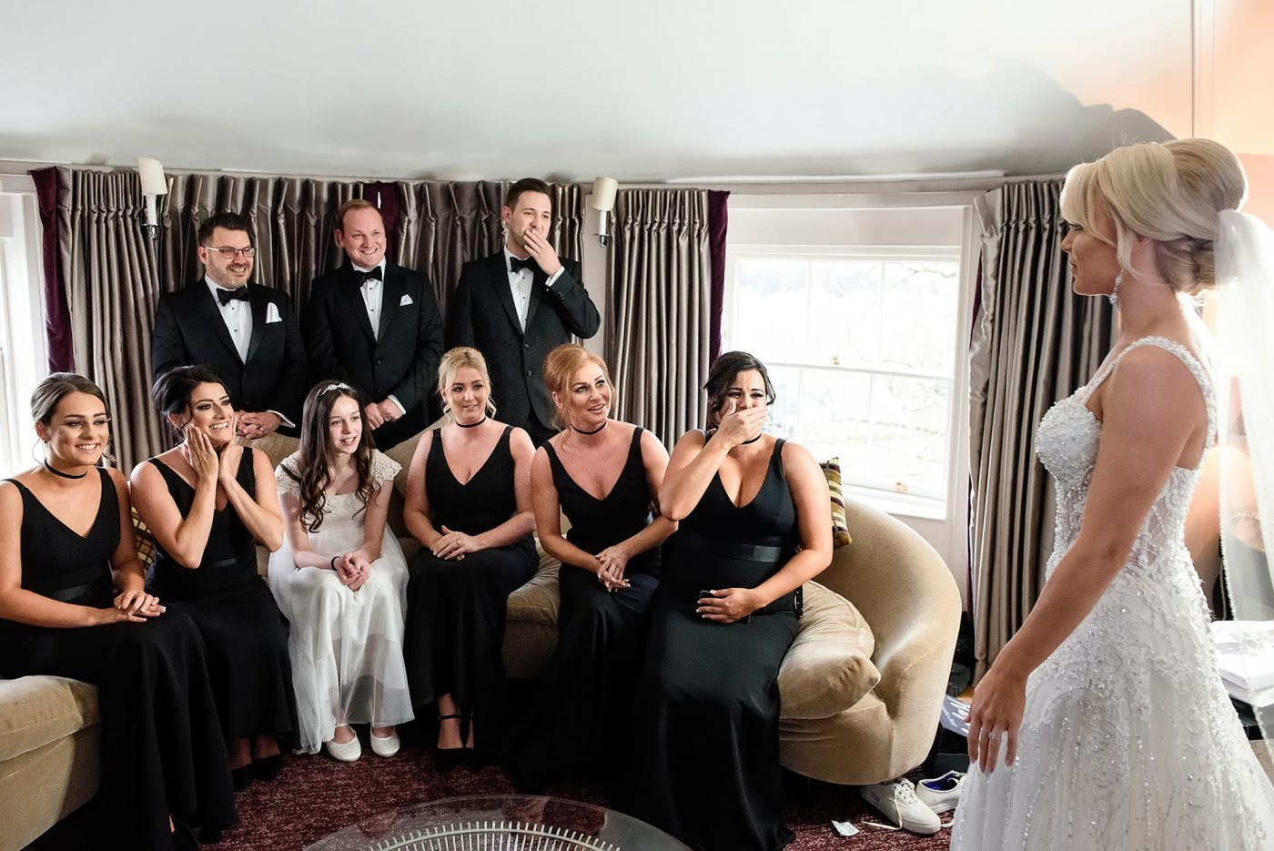 bridal party see the bride in her dress