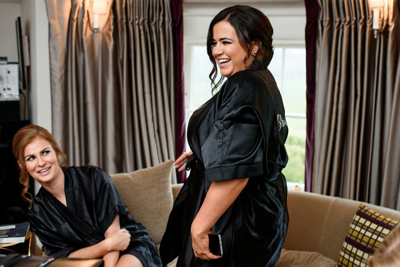 bridesmaids laughing black satin dressing gowns