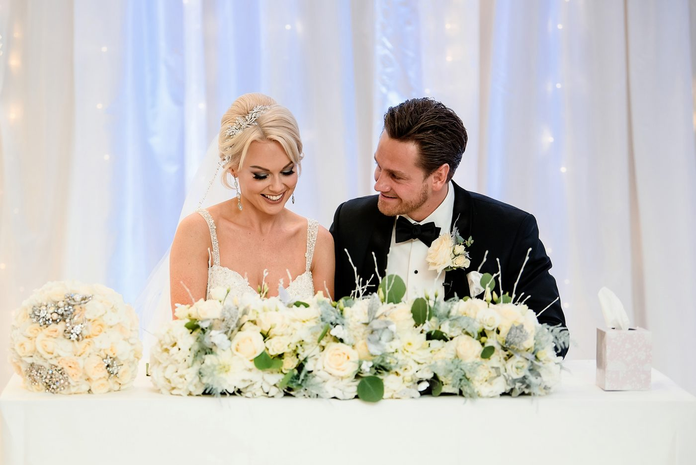 husband and wife signing the register