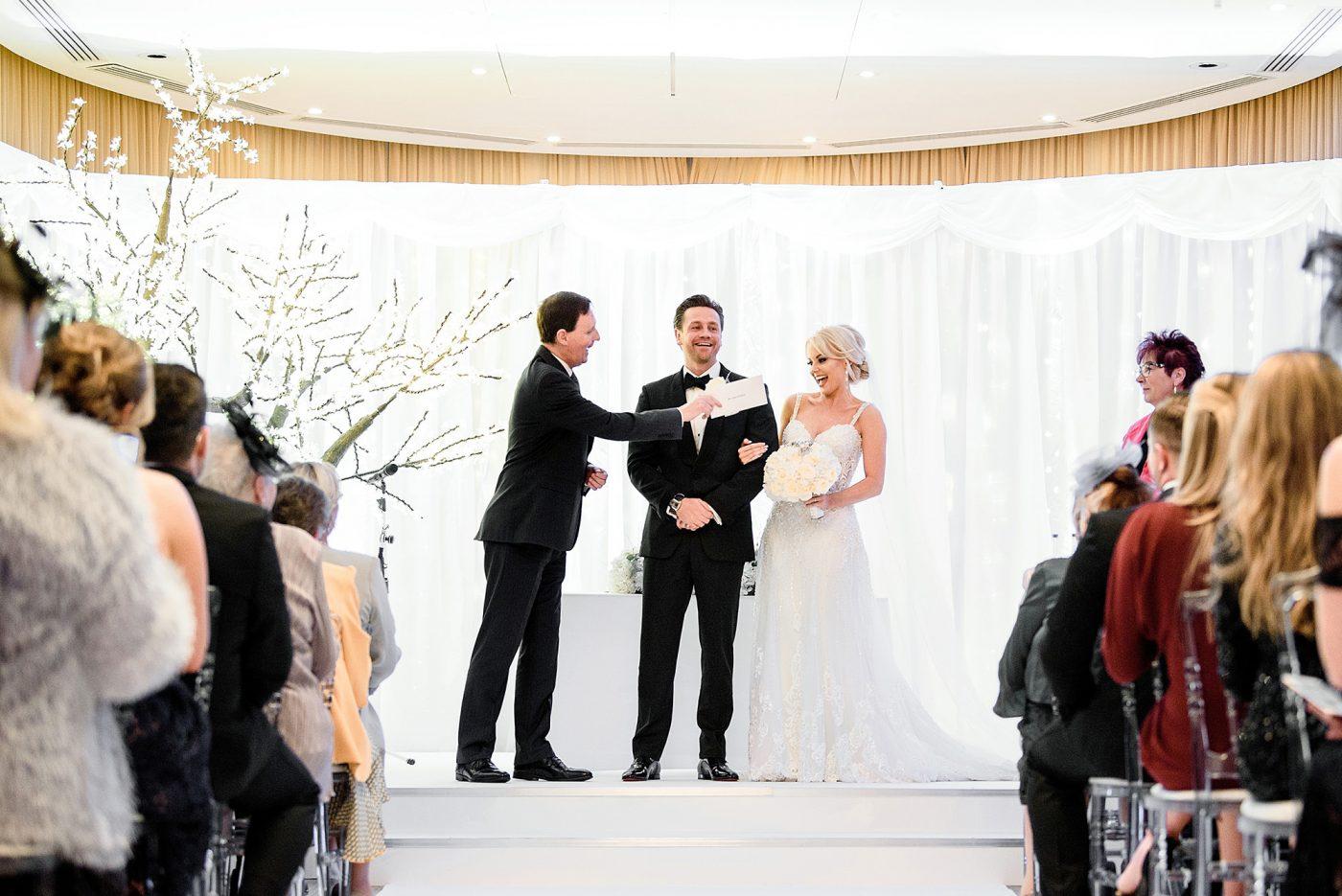registrar hands bride the marriage certificate