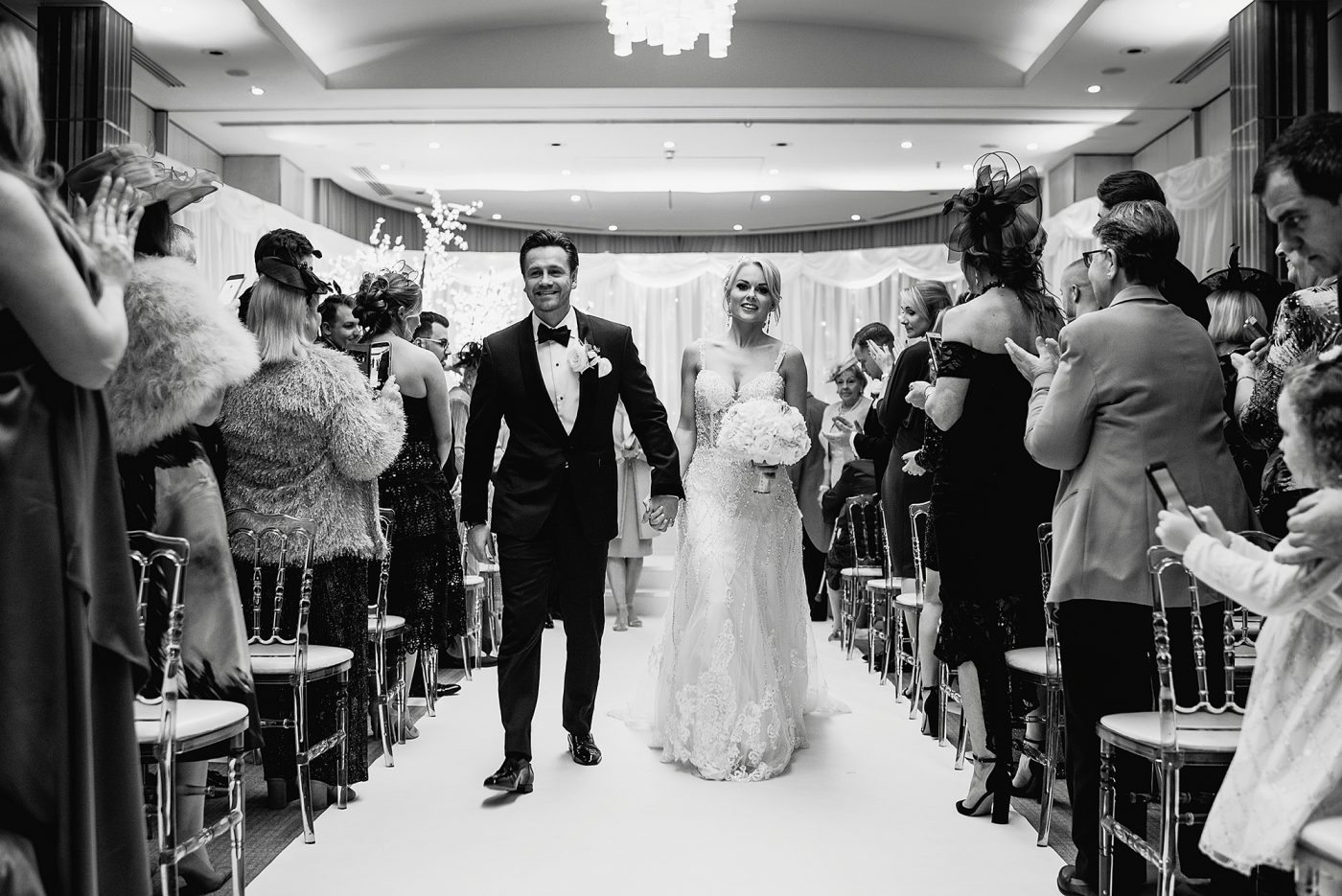 bride and groom walk down the aisle