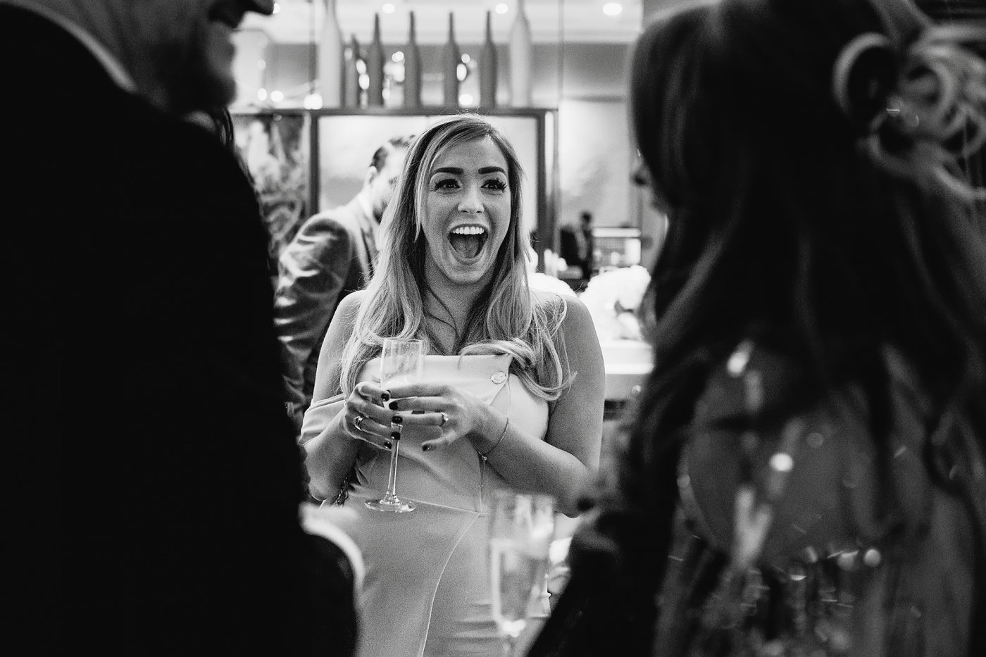 candid documentary photo of guest laughing