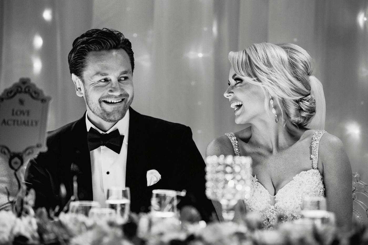 bride and groom looking at eachother and laughing