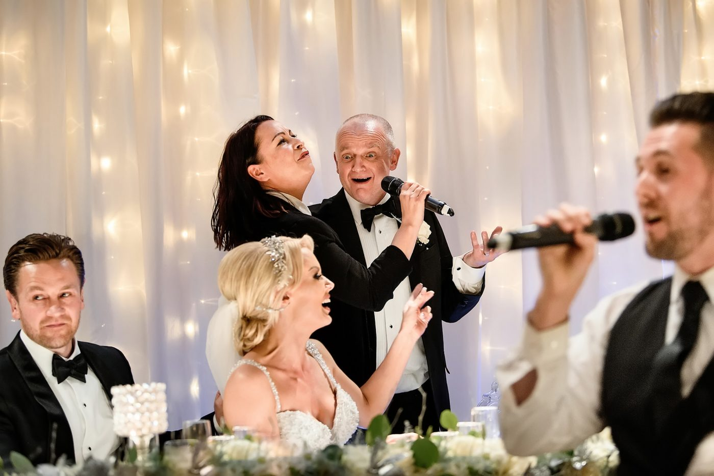 father of the bride sings with waiters