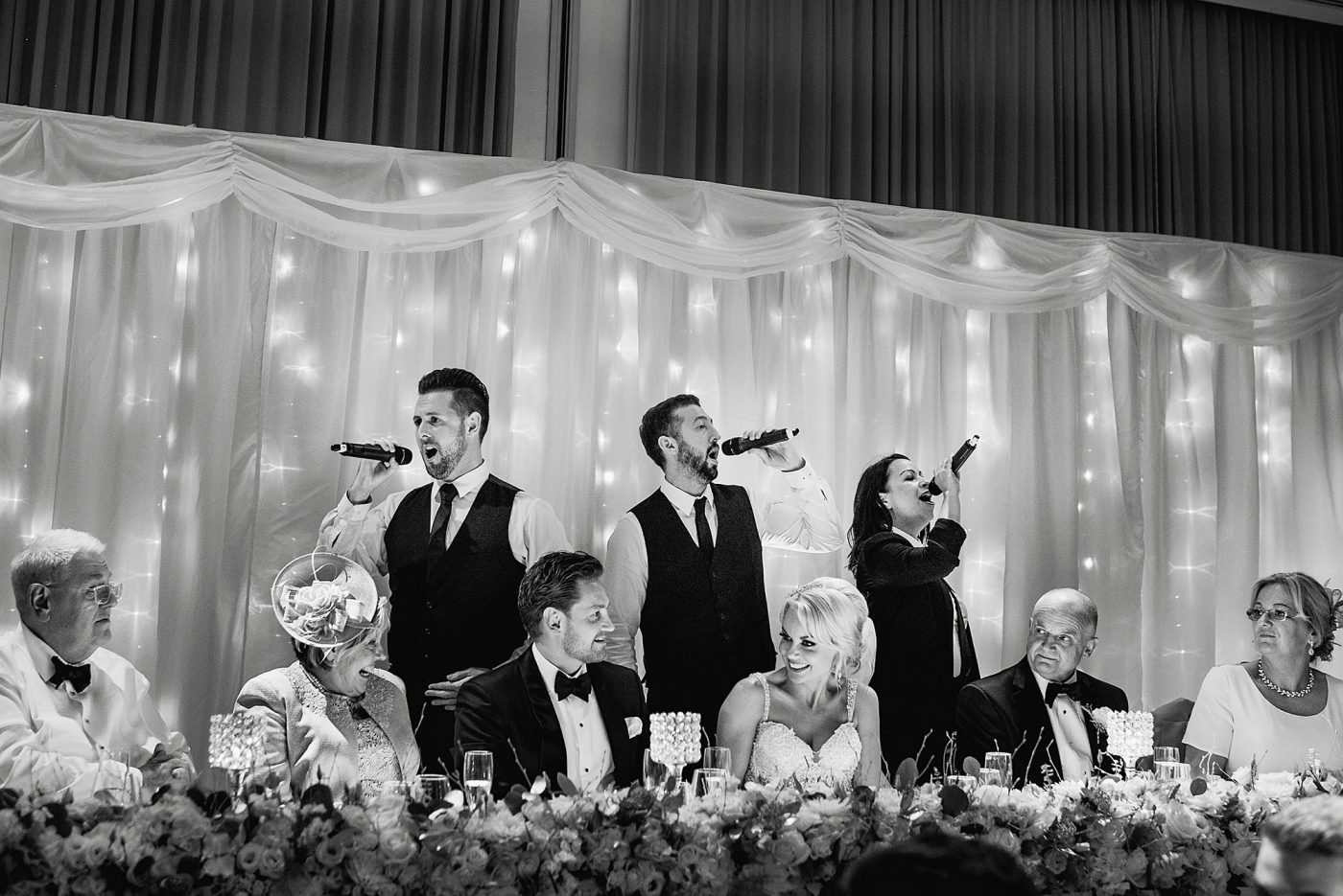 singing waiters at luxury hotel wedding