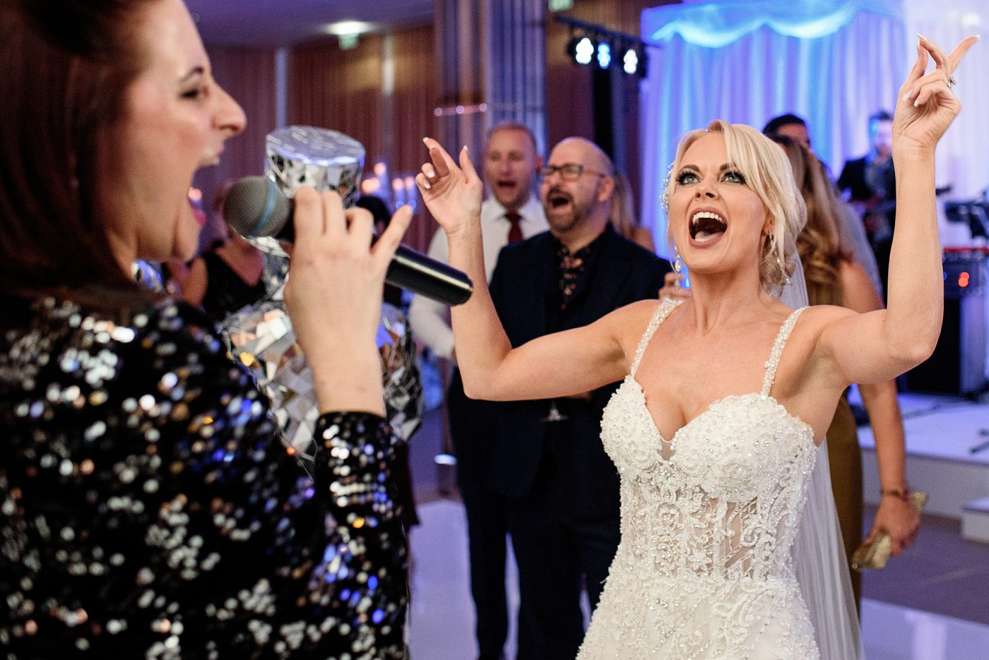 bride singing on the dance floor