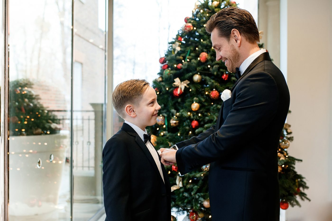 groom helping page boy get ready