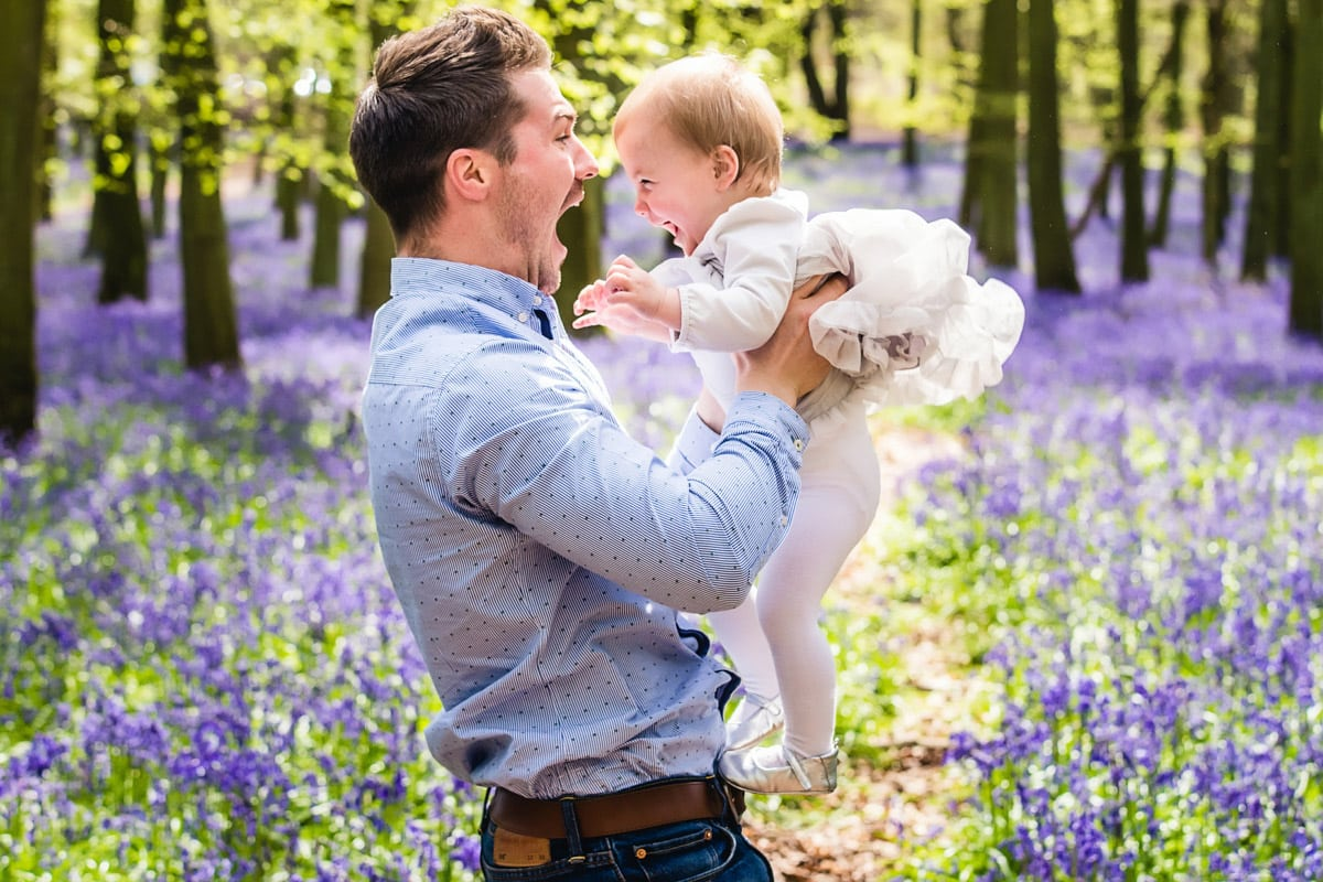Father and daughter with bluebells