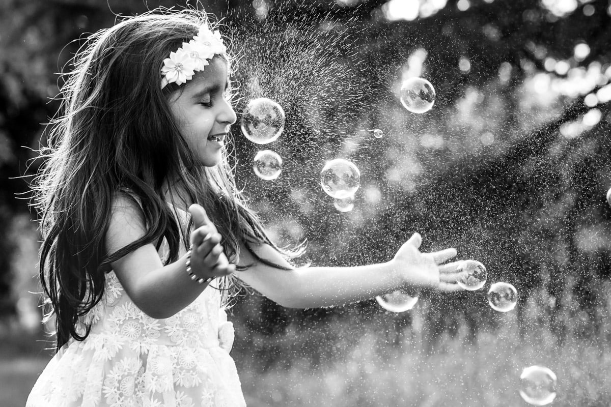 Bubble burst on girl's nose
