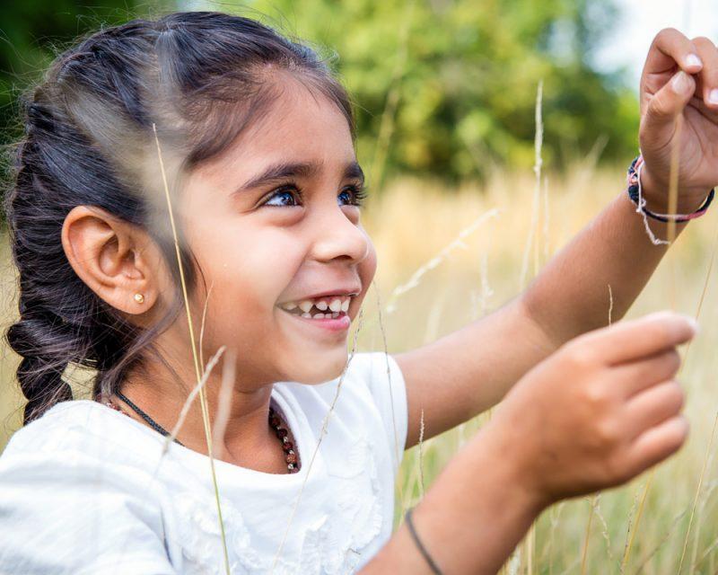 Girl picking grass
