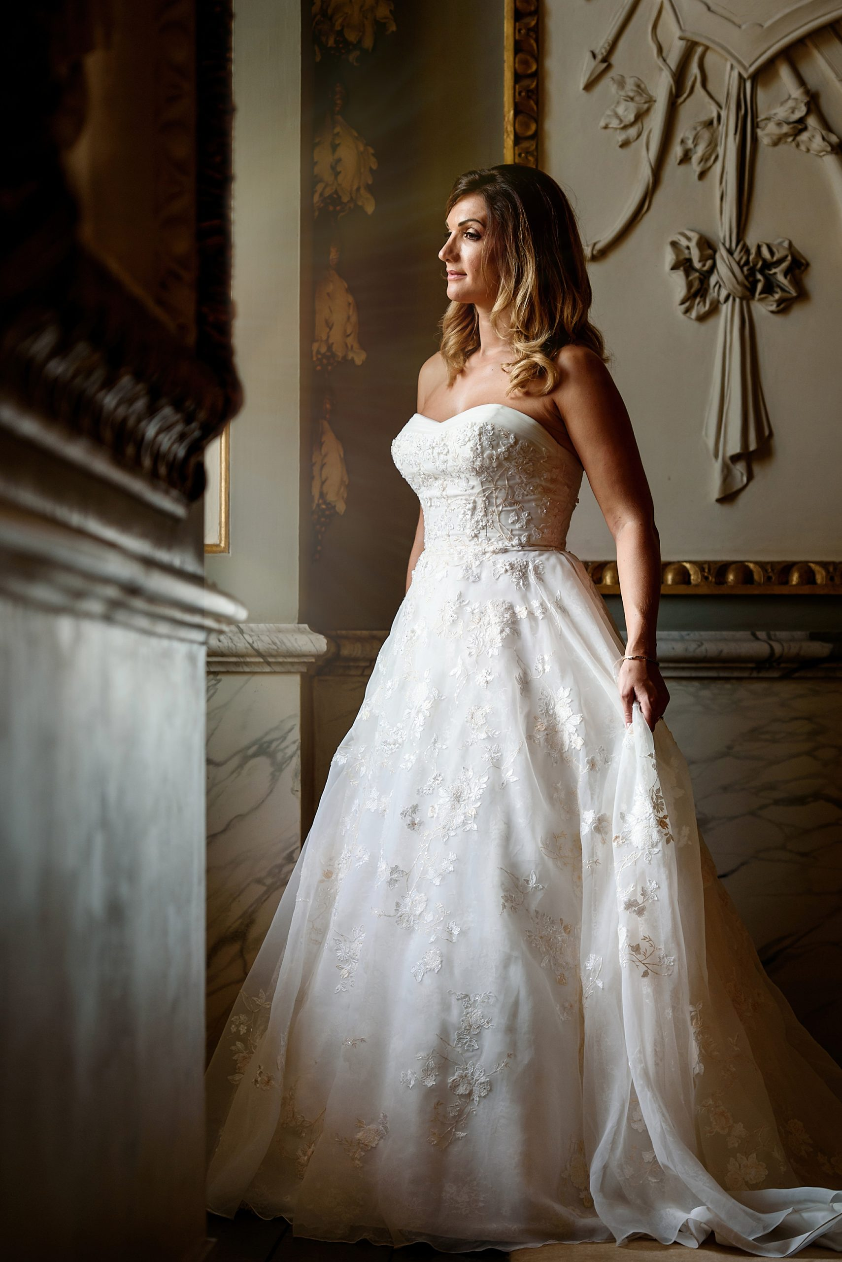 bridal portrait by the window in ornate room