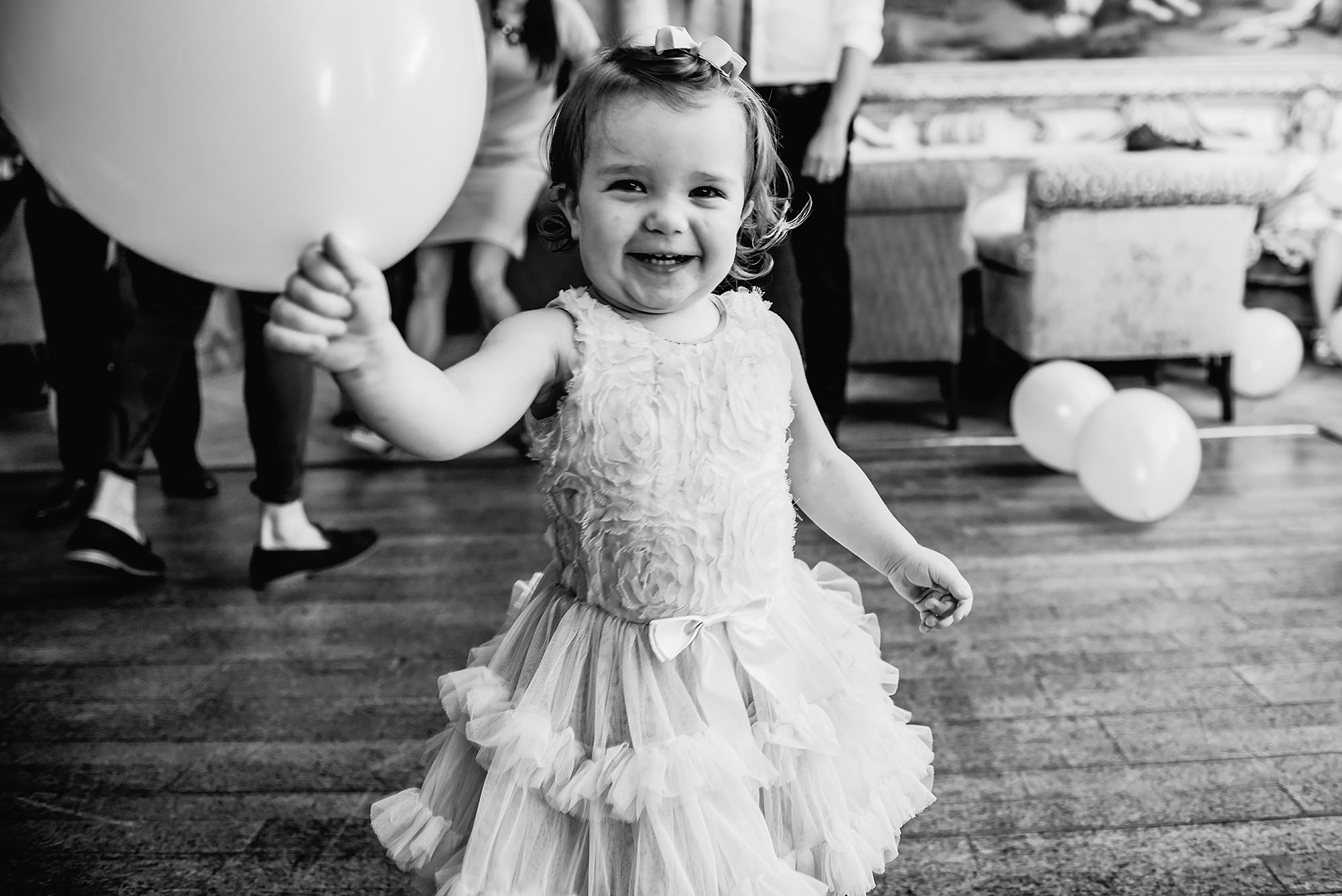 flower girl laughing with balloon