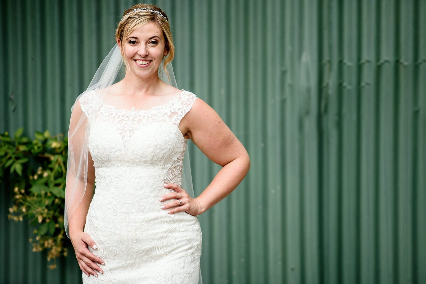 bridal portrait in front of green barn