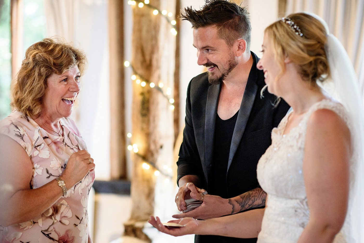 magician doing trick for mother of the bride