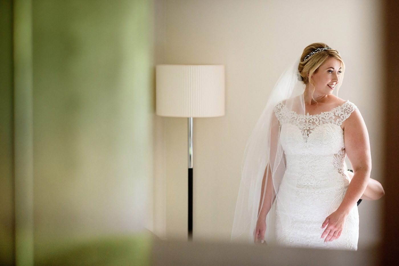 bride looking in the mirror before the wedding