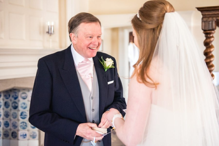 bride laughing with dad