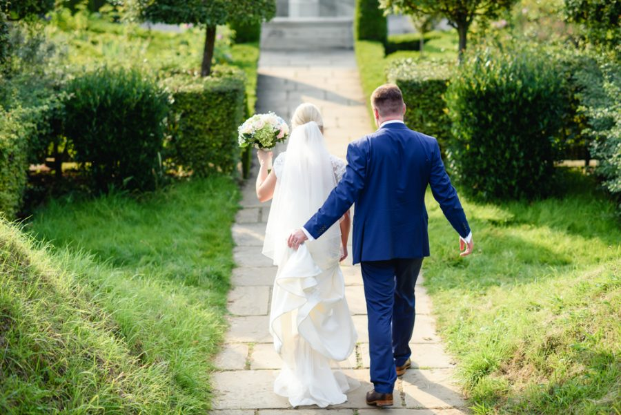 Hatfield house wedding bride and groom walking