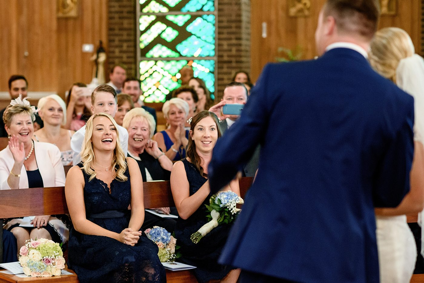 guests cheering during service
