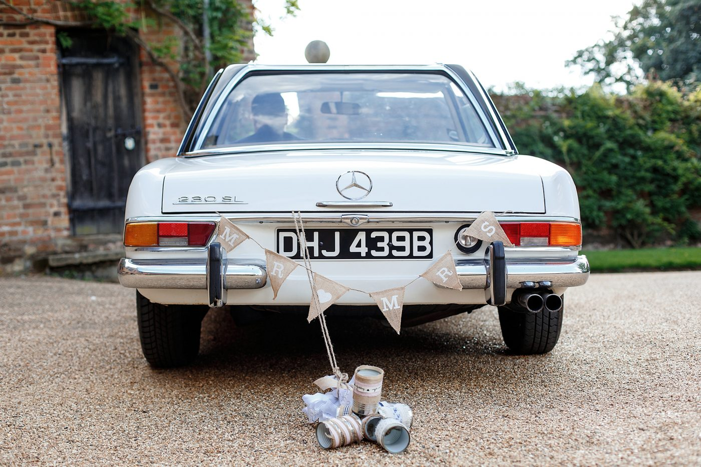 tin cans tied to wedding car