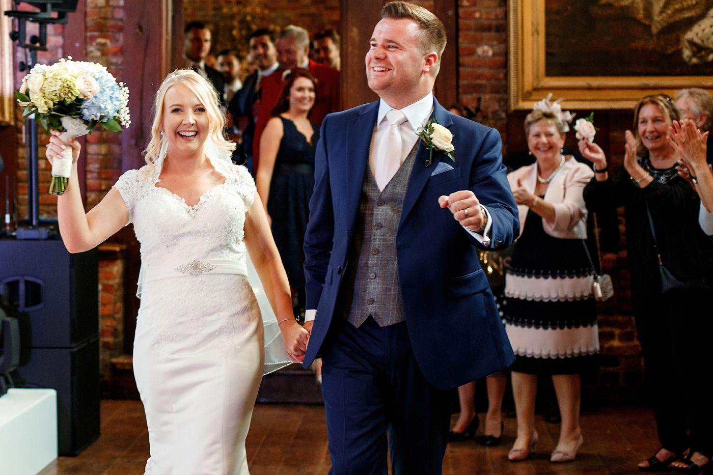 bride and groom dance into the reception room