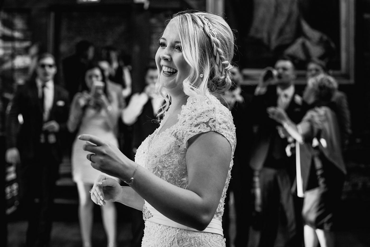 black and white picture of bride smiling
