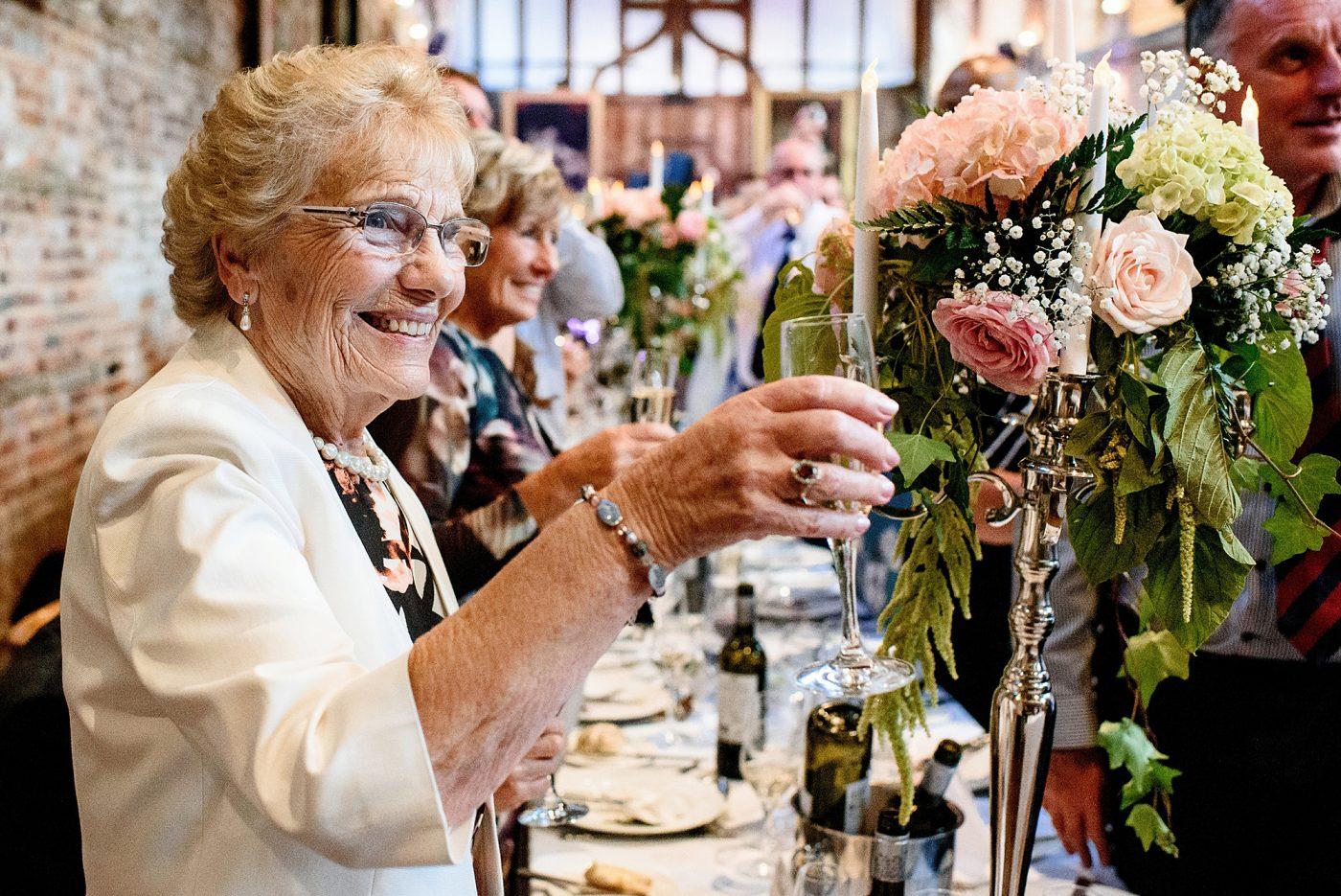 grandma toasting the happy couple
