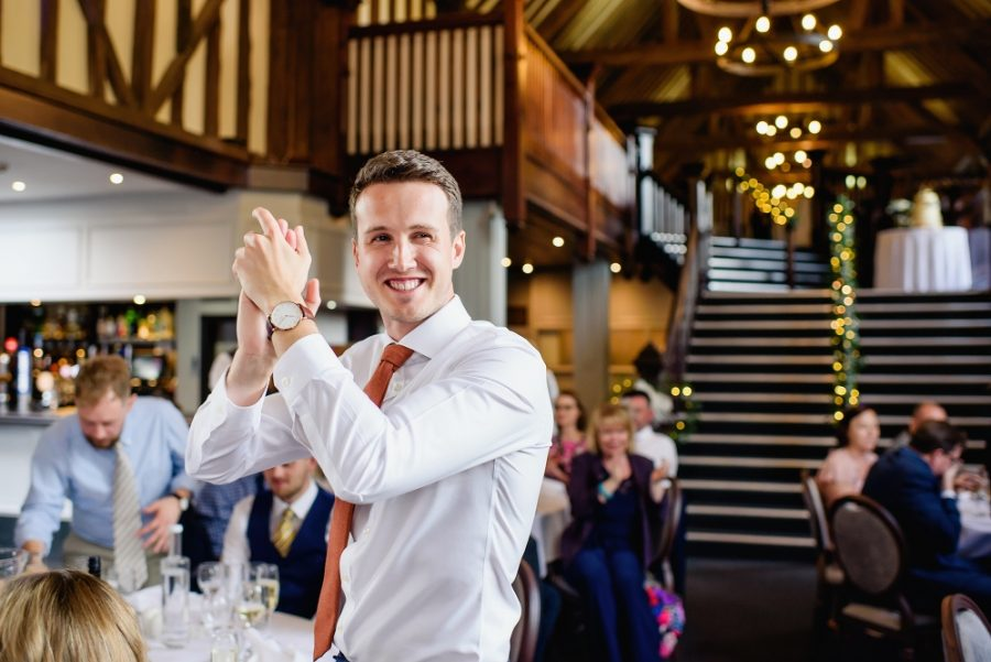 guests clapping at golf club wedding