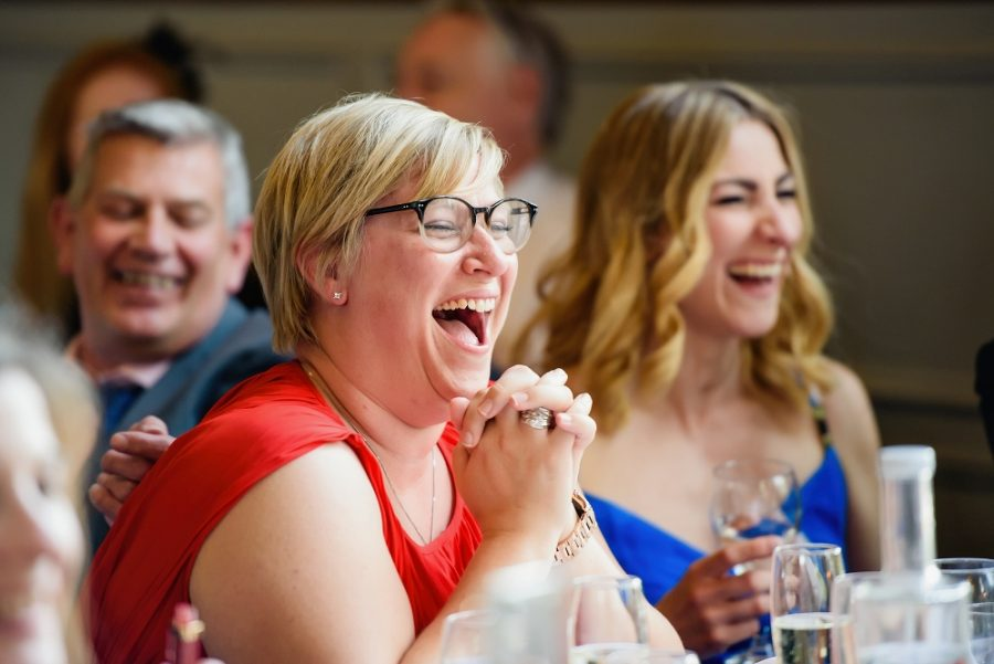 guests laughing at golf club wedding