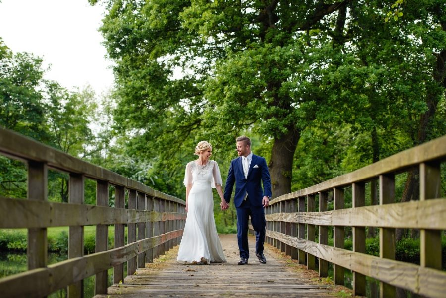 Couple walking along bridge at Essendon Country club