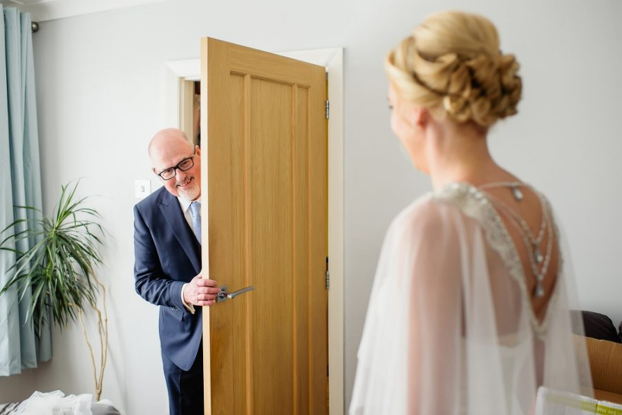dad sees bride in her dress
