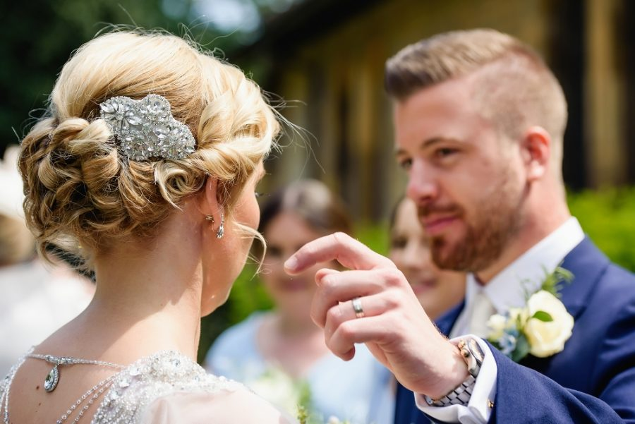 groom adjusts brides hair