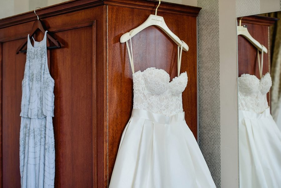 wedding dress hung on wardrobe