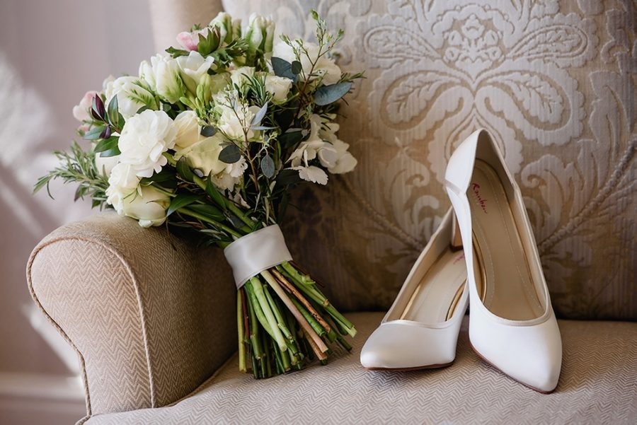 shoes and bouquet on chair