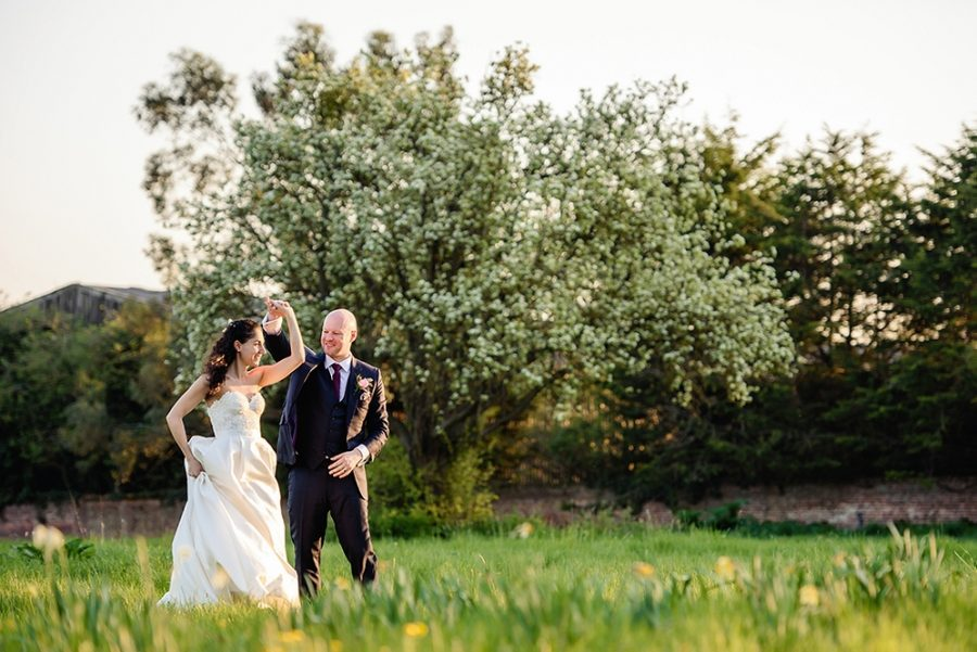couple dancing in the grass at lillibrooke manor