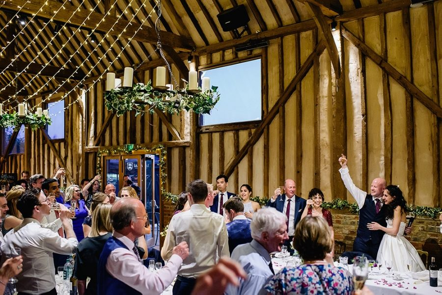 groom toasts at barn wedding