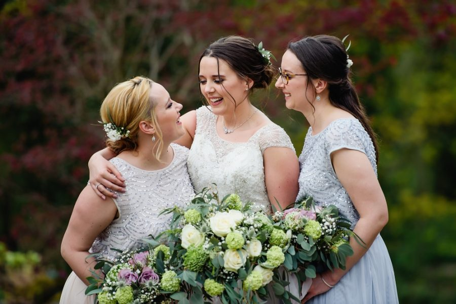 bride with bridesmaids at wotton house wedding