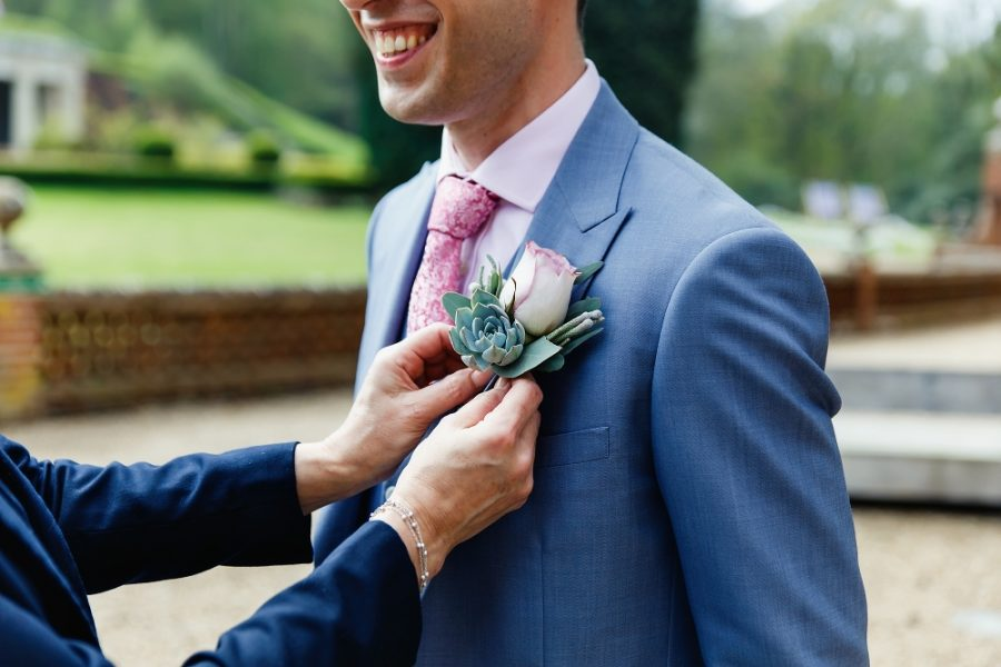 usher adjusting buttonhole