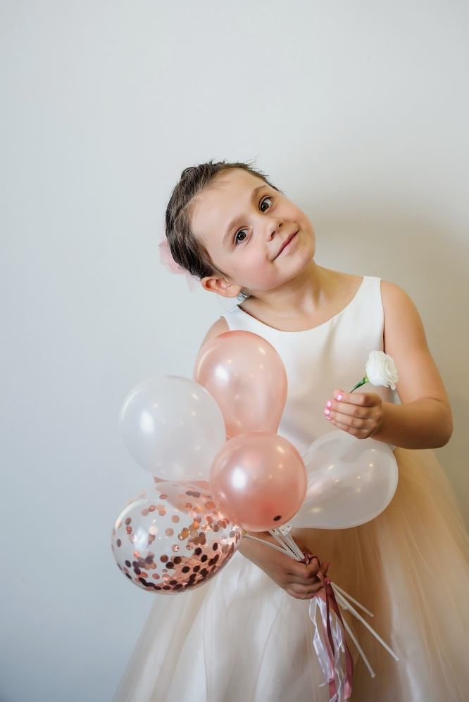 flower girl with pink balloons