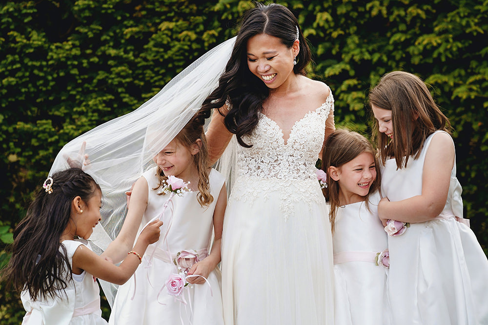 natural bride with flower girls group photo