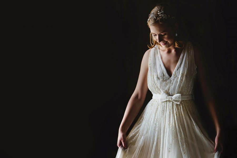 bride in dramatic natural light at st michaels manor in hertfordshire wedding venue