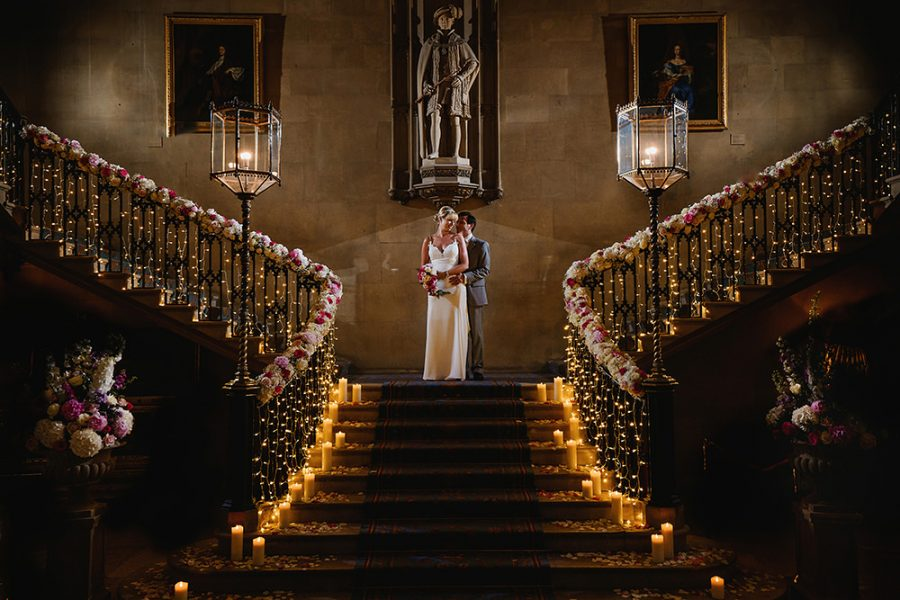 wedding photo of bride and groom on staircase at Ashridge House