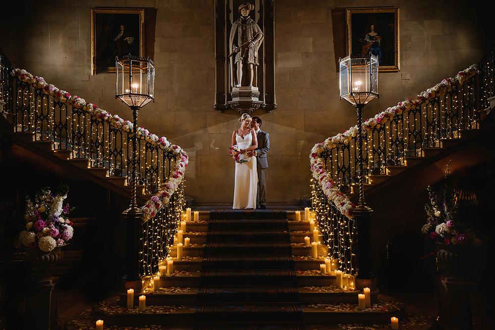 hertfordshire wedding photo of bride and groom on staircase at ashridge house