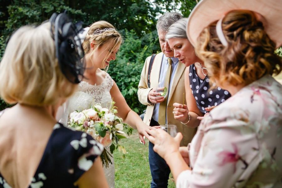 guests looking at brides wedding ring