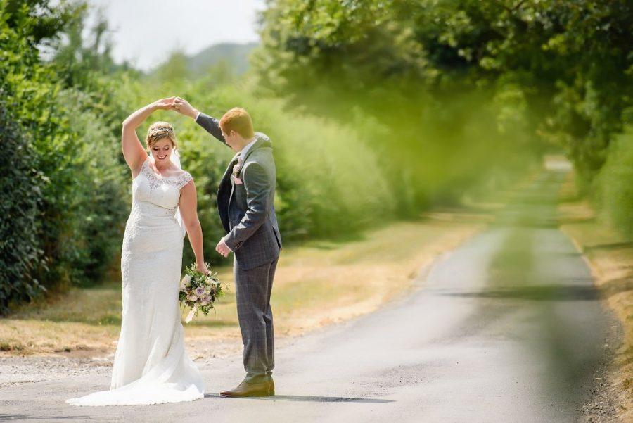 bride and groom dancing at rustic country wedding venue