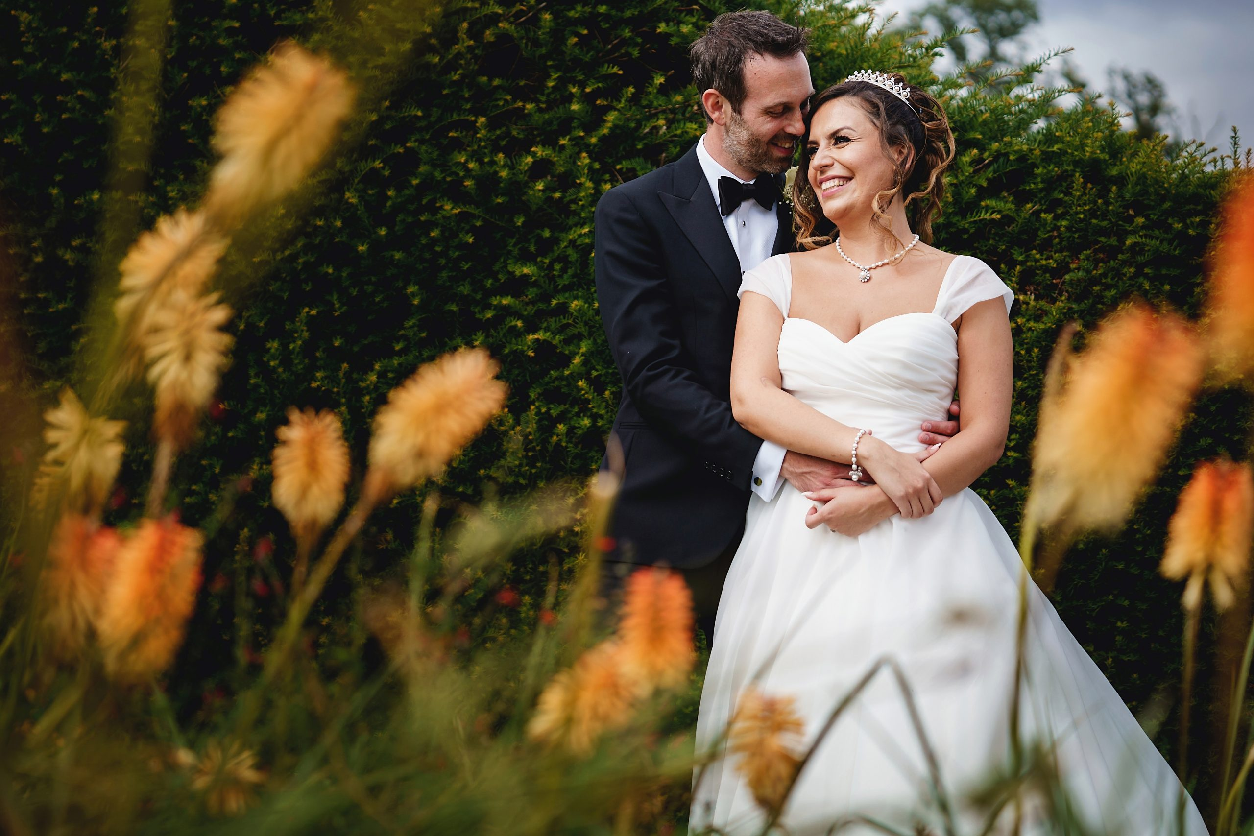 Bride and groom in gardens at Micklefield Hall Hertfordshire