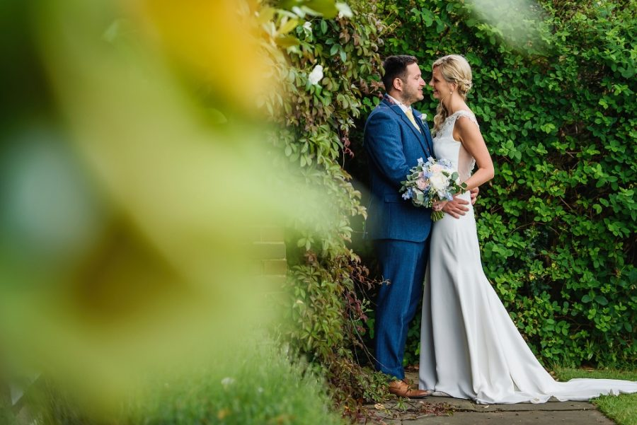 Bride and groom portrait in gardens at Micklefield Hall