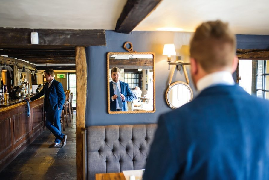groom in the pub on the morning of his wedding