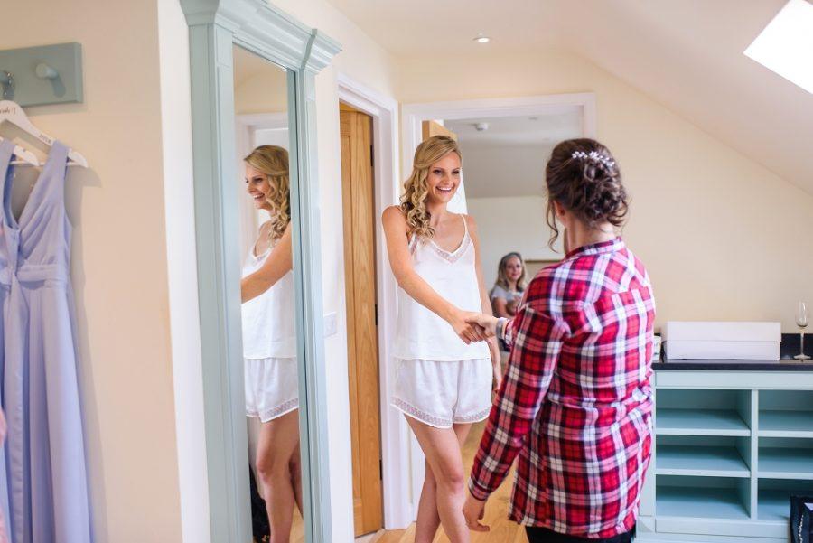 bride with bridesmaid reflection